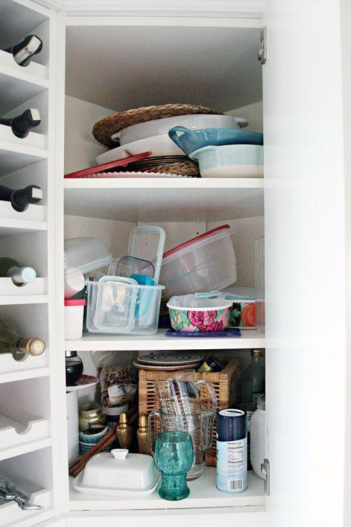 <p>It's easy to turn an awkward cabinet into a catch-all for extra Tupperware and kitchen utensils.</p>