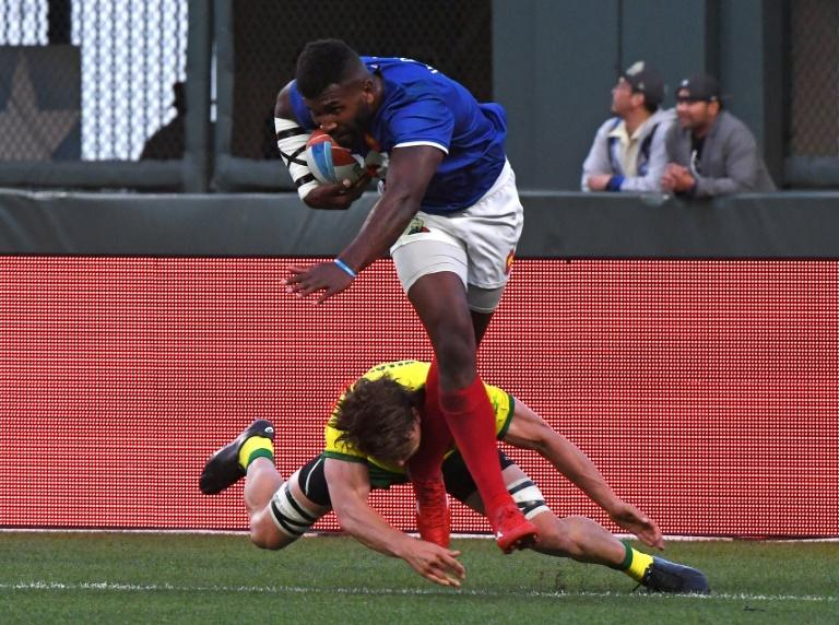 Tavite Veredamu of France runs to score the winning try against Australia during their men's round of 16 games at the Rugby Sevens World Cup in San Francisco