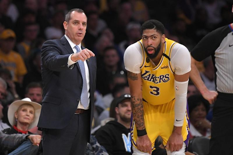 Los Angeles Lakers head coach Frank Vogel, left, talks with forward Anthony Davis.