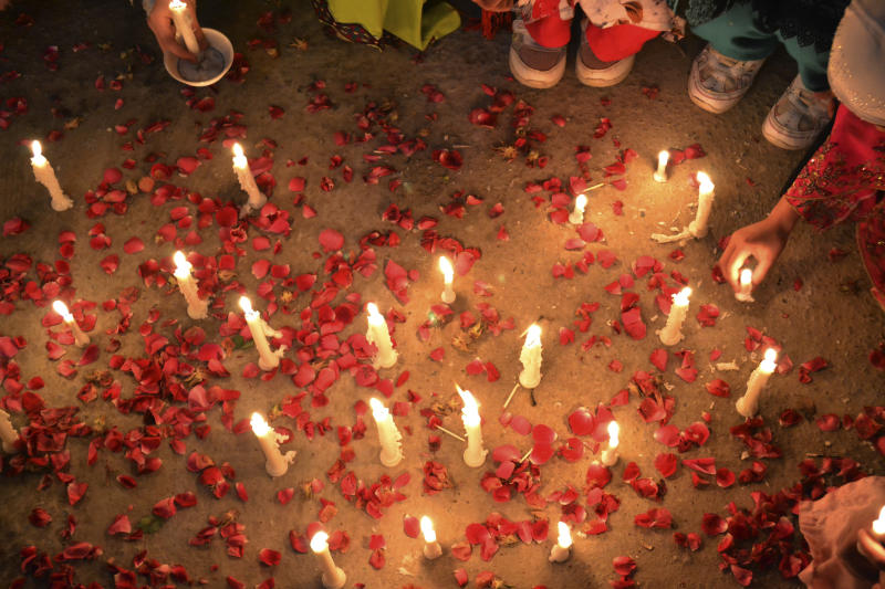 Pakistani children, hold candles during a vigil to condemn the attacks on their ethnic Hazara community, in Quetta, Pakistan, Sunday, Feb. 16, 2014. (AP Photo/Arshad Butt)