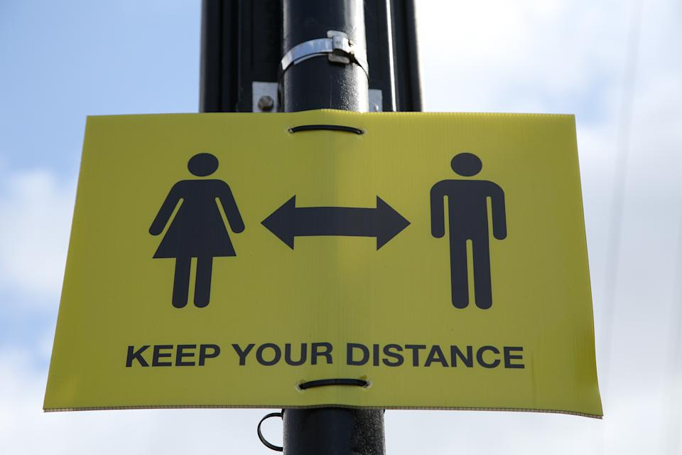 A 'Keep your distance' sign seen displayed in London. (Photo by Dinendra Haria / SOPA Images/Sipa USA)