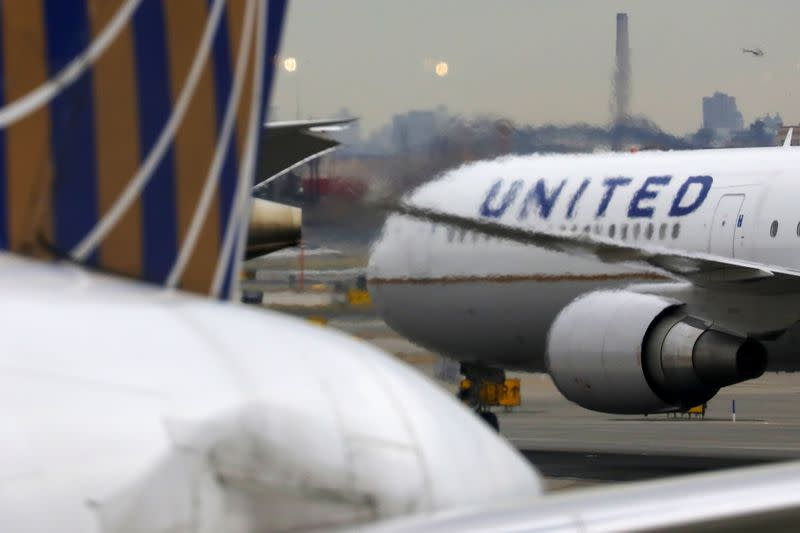 A United Airlines passenger jet taxis at Newark Liberty International Airport
