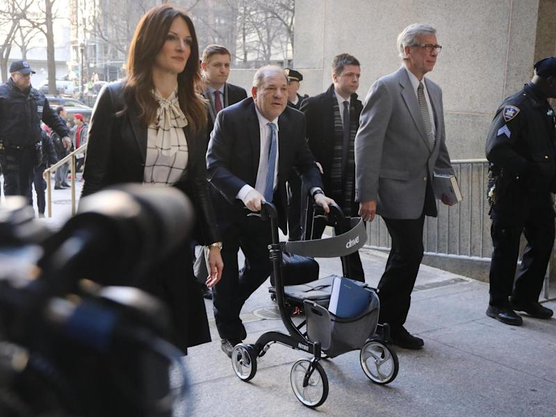 Harvey Weinstein staggers into a New York courtroom in February, accompanied by his lawyer, Donna Rotunno (left): Spencer Platt/Getty Images