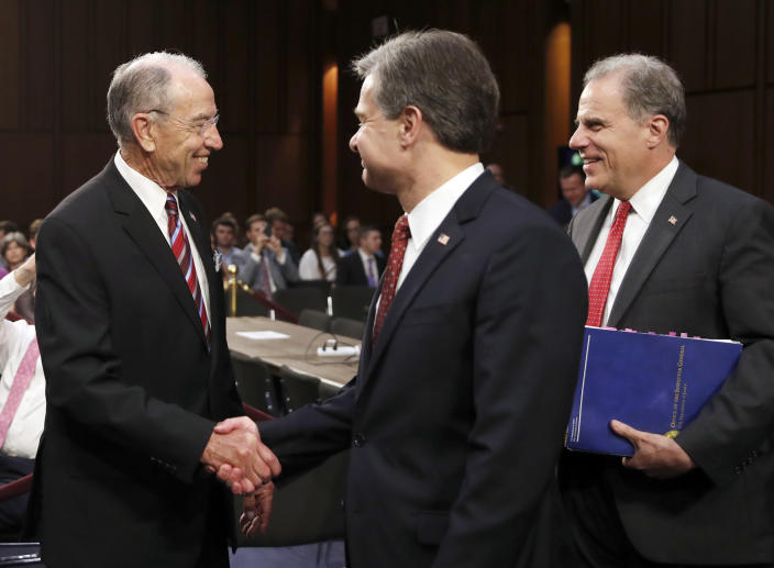 Chuck Grassley, left, shakes hands with Christopher Wray