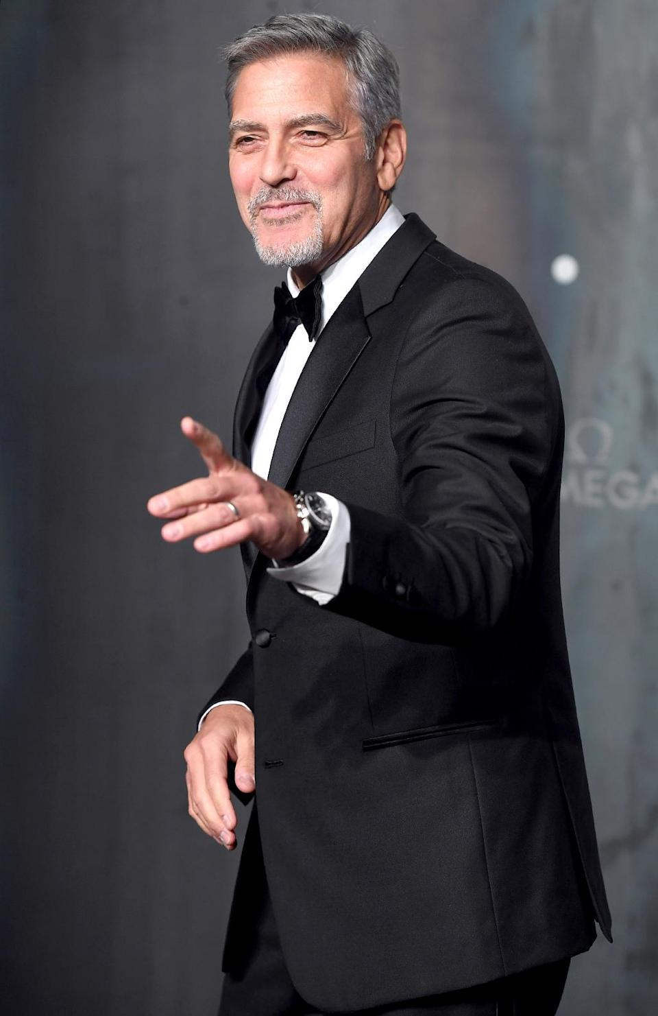 """<p>The dashing actor had some fun Wednesday at watch brand Omega's Lost in Space event, celebrating 60 years of its Speedmaster model, in London. Then again, <a rel=""""nofollow"""" href=""""https://www.yahoo.com/celebrity/george-clooney-rides-shotgun-burt-reynolds-sort-125740775.html"""" data-ylk=""""slk:when is that guy not having fun;outcm:mb_qualified_link;_E:mb_qualified_link;ct:story;"""" class=""""link rapid-noclick-resp yahoo-link"""">when is that guy <i>not</i> having fun</a>? (Photo: Karwai Tang/WireImage) </p>"""