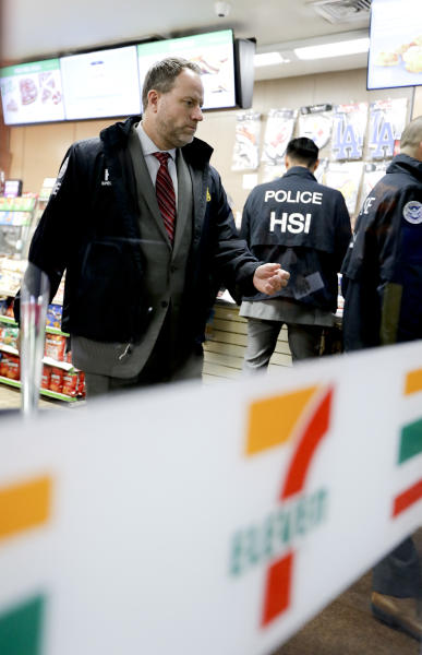 Christopher Kuemmerle, a group supervisor for U.S. immigration and Customs Enforcement's Homeland Security Investigations unit watches as agents serve an employment audit notice at a 7-Eleven convenience store Wednesday, Jan. 10, 2018, in Los Angeles. Agents said they targeted about 100 7-Eleven stores nationwide Wednesday to open employment audits and interview workers. (AP Photo/Chris Carlson)