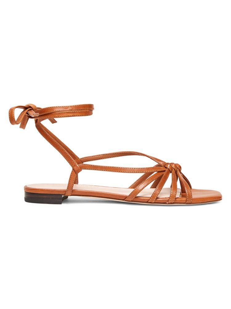 """<p><strong>Loeffler Randall</strong></p><p>saksfifthavenue.com</p><p><strong>$168.75</strong></p><p><a href=""""https://go.redirectingat.com?id=74968X1596630&url=https%3A%2F%2Fwww.saksfifthavenue.com%2Floeffler-randall-lorelai-flat-ankle-wrap-leather-sandals%2Fproduct%2F0400012336136&sref=https%3A%2F%2Fwww.harpersbazaar.com%2Ffashion%2Ftrends%2Fg31902874%2Fsaks-spring-2020-sale%2F"""" rel=""""nofollow noopener"""" target=""""_blank"""" data-ylk=""""slk:Shop Now"""" class=""""link rapid-noclick-resp"""">Shop Now</a></p><p>A flat sandal to take you from brunch to the beach.</p>"""