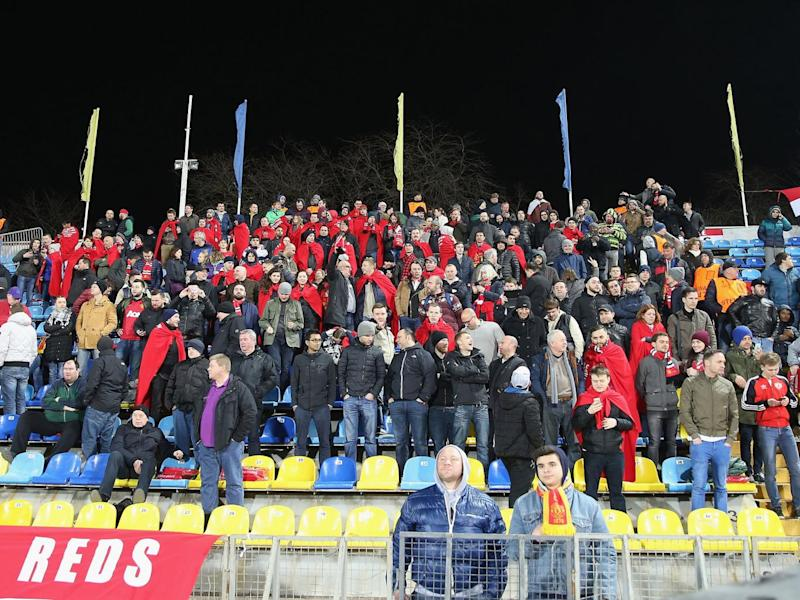 United supporters wearing their blankets in Rostov (Man Utd via Getty)