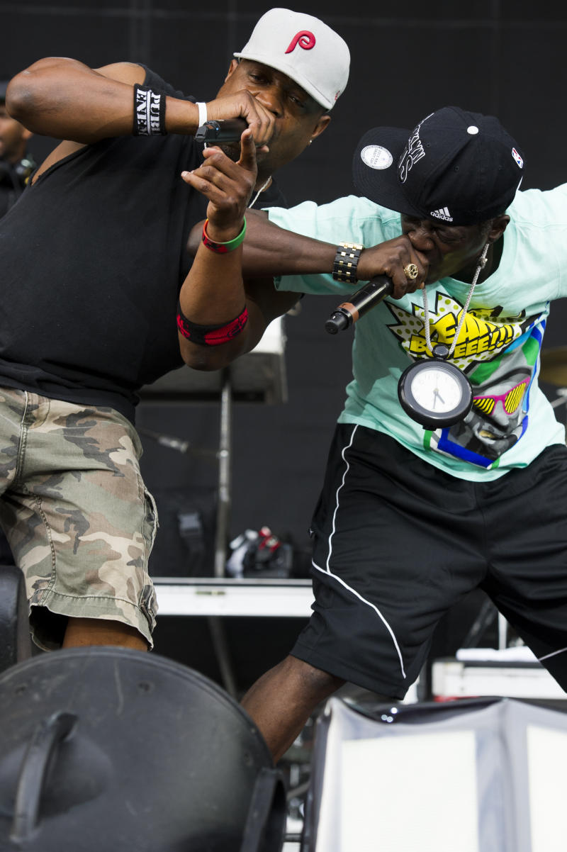 Chuck D, left, and Flavor Flav from the group Public Enemy perform on day one of the 2013 Budweiser Made in America Festival on Saturday, Aug. 31, 2013 in Philadelphia, PA. (Photo by Charles Sykes/Invision/AP)