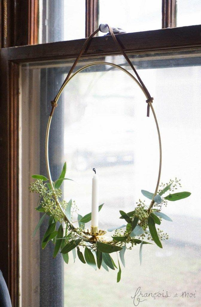 """<p>Candles are a fixture in windows around the holidays, but we think you should put a new spin on the look. This metal hoop wreath will do just that.</p><p><strong>Get the tutorial at <a href=""""https://francoisetmoi.com/diy/candle-wreath/"""" rel=""""nofollow noopener"""" target=""""_blank"""" data-ylk=""""slk:François et Moi"""" class=""""link rapid-noclick-resp"""">François et Moi</a>.</strong></p><p><strong><a class=""""link rapid-noclick-resp"""" href=""""https://www.amazon.com/Darice-17160-17160Metal-Macrame-Ring-Gold-12/dp/B004BPV3D8/?tag=syn-yahoo-20&ascsubtag=%5Bartid%7C10050.g.23343056%5Bsrc%7Cyahoo-us"""" rel=""""nofollow noopener"""" target=""""_blank"""" data-ylk=""""slk:SHOP METAL HOOPS"""">SHOP METAL HOOPS</a><br></strong></p>"""