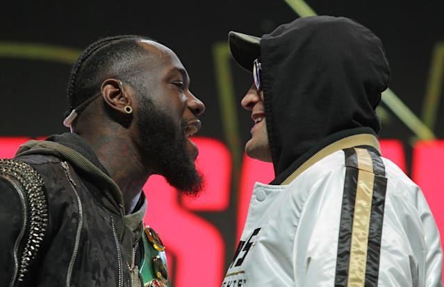 Deontay Wilder and Tyson Fury get into an altercation during their news conference Feb. 19, 2020 at the MGM Grand Las Vegas in Las Vegas. (John Gurzinski/AFP via Getty Images)