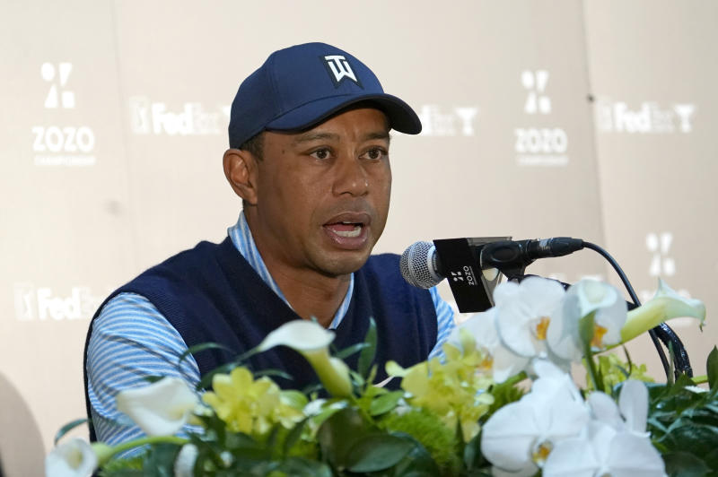 Tiger Woods of the United States answers a reporter's question during a news conference ahead of the Challenge: Japan Skins event at Accordia Golf Narashino C.C. in Inzai, Japan, Monday, Oct. 21, 2019. Tiger Woods will play at the Zozo Championship PGA Tour which will be held at Oct. 24-27. (AP Photo/Lee Jin-man)