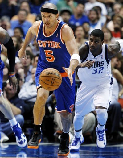 New York Knicks' Jason Kidd (5) comes away with a steal against Dallas Mavericks' Chris Kaman, not pictured, as O.J. Mayo (32) gives chase in the first half of an NBA basketball game, Wednesday, Nov. 21, 2012, in Dallas. (AP Photo/Tony Gutierrez)