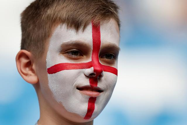<p>An England fan inside the stadium before the match </p>