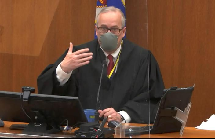 In this screen grab from video, Hennepin County Judge Peter Cahill presides over pretrial motions prior to continuing jury selection in the trial of former Minneapolis police officer Derek Chauvin, Wednesday, March 10, 2021, at the Hennepin County Courthouse in Minneapolis.  Chauvin is charged in the May 25, 2020 death of George Floyd.