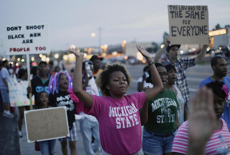 Demonstrators protest the shooting of Michael Brown on August 22, 2014 in Ferguson, Missouri