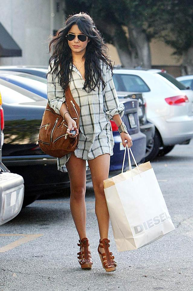 """Bandslam"" star Vanessa Hudgens pairs her oversized plaid shirt (let's hope there are some shorts underneath!) with platform shoes, a zippered suede bag, and a cuff bracelet. Max Butterworth/ PacificCoastNews.com - April 21, 2009"