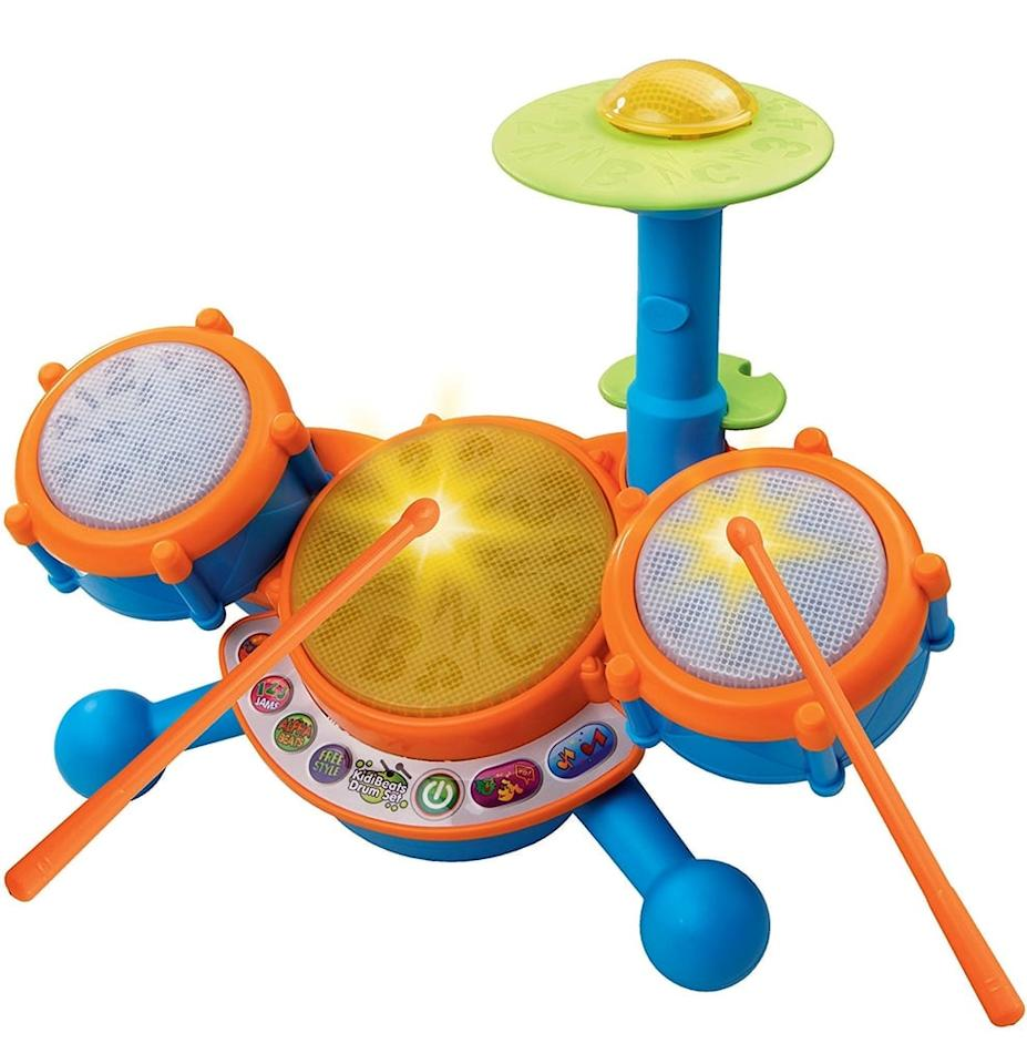 """<p>If you feel like you have a tiny musician on your hands, try out the <a href=""""https://www.popsugar.com/buy/VTech-KidiBeats-Drum-Set-98532?p_name=VTech%20KidiBeats%20Drum%20Set&retailer=amazon.com&pid=98532&price=18&evar1=moms%3Aus&evar9=25764376&evar98=https%3A%2F%2Fwww.popsugar.com%2Ffamily%2Fphoto-gallery%2F25764376%2Fimage%2F44849599%2FVTech-KidiBeats-Drum-Set&list1=amazon%2Choliday%2Ctoys%2Cgift%20guide%2Ceducation%2Cbabies%2Cvtech%2Cgifts%20for%20kids%2Choliday%20living%2Choliday%20for%20kids%2Cgifts%20for%20babies&prop13=mobile&pdata=1"""" rel=""""nofollow"""" data-shoppable-link=""""1"""" target=""""_blank"""" class=""""ga-track"""" data-ga-category=""""Related"""" data-ga-label=""""https://www.amazon.com/VTech-KidiBeats-Kids-Drum-Set/dp/B007XVYSDE/ref=sr_1_8?s=toys-and-games&amp;ie=UTF8&amp;qid=1506445479&amp;sr=1-8&amp;refinements=p_n_age_range%3A165890011"""" data-ga-action=""""In-Line Links"""">VTech KidiBeats Drum Set</a> ($18). The drum pads and cymbal each have their own unique sound for sensory development. </p>"""