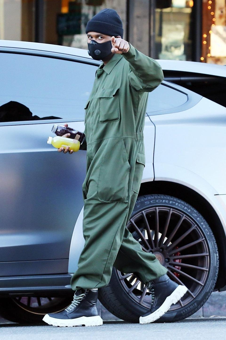 <p>Usher gives a nod to photographers on Friday while grabbing some fresh juice in L.A.</p>