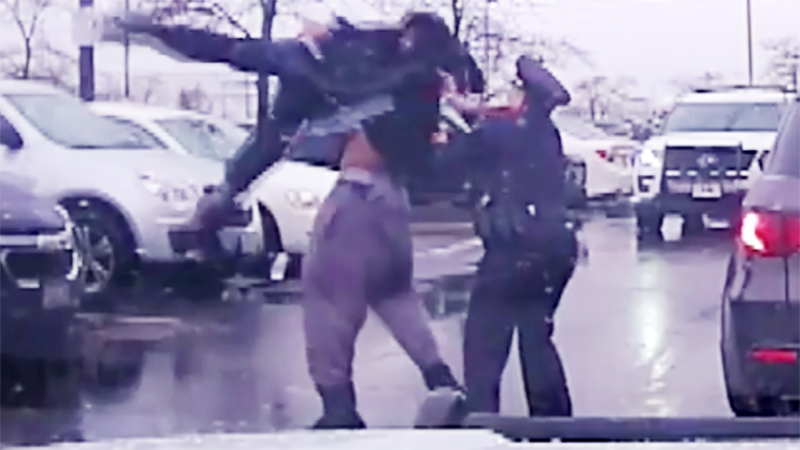 Michael Harris, pictured here picking up the officer before slamming him to the ground.