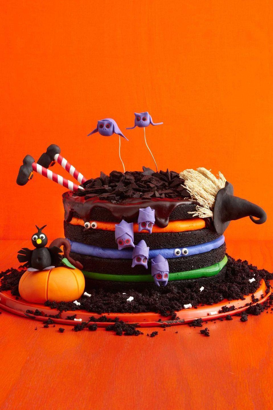 """<p>You don't need a special spell to put together this fun black chocolate witch cake — just colorful buttercream and spooky decorations.<em><br><br><a href=""""https://www.womansday.com/food-recipes/food-drinks/recipes/a51843/black-chocolate-cake/"""" rel=""""nofollow noopener"""" target=""""_blank"""" data-ylk=""""slk:Get the recipe for Black Chocolate Witch Cake"""" class=""""link rapid-noclick-resp"""">Get the recipe for Black Chocolate Witch Cake</a>.</em><br></p>"""