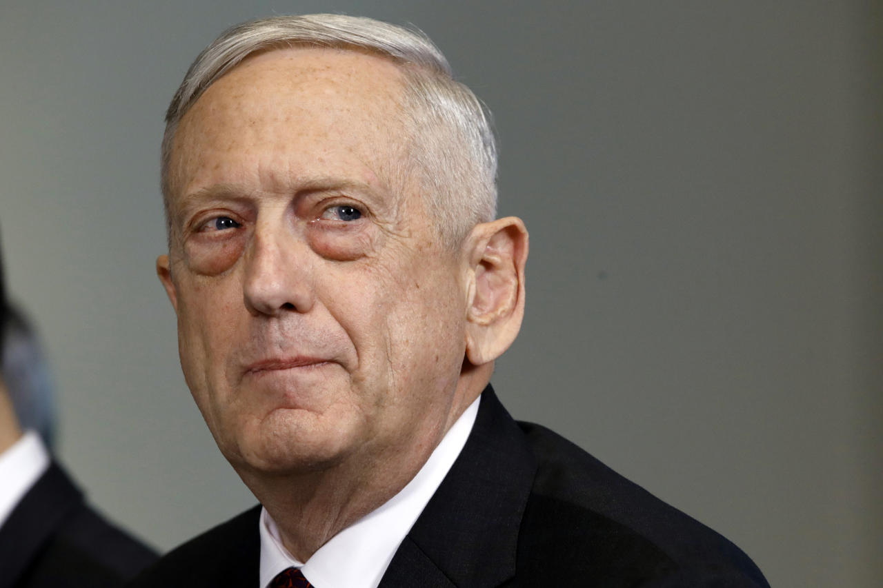 FILE - In this Friday April 27, 2018, file photo, Defense Secretary Jim Mattis listens to a question during a meeting at the Pentagon, in Washington. The Pentagon is preparing to build temporary camps for immigrants at two military bases, Mattis said Sunday, June 24, 2018. (AP Photo/Jacquelyn Martin, File)