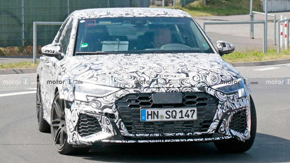 """<p>While the <a href=""""https://www.motor1.com/audi/rs3-sedan/"""" rel=""""nofollow noopener"""" target=""""_blank"""" data-ylk=""""slk:Audi RS3"""" class=""""link rapid-noclick-resp"""">Audi RS3</a> hatchback won't come to the US, the sedan version will come to America. Here it is! Expect there to be a turbocharged five-cylinder making around 394 horsepower (294 kilowatts) in the standard tune. There's a rumor of a Performance version later with as much as 444 hp (331 kW).</p> <h3><a href=""""https://www.motor1.com/news/435659/audi-rs3-sedan-spied-nurburgring/"""" rel=""""nofollow noopener"""" target=""""_blank"""" data-ylk=""""slk:Audi RS3 Sedan Spied Looking Almost Ready For Production"""" class=""""link rapid-noclick-resp"""">Audi RS3 Sedan Spied Looking Almost Ready For Production</a></h3> <h2>Enjoy These Looks At The RS3:</h2><br><a href=""""https://www.motor1.com/news/435833/audi-rs3-checkered-flag-headlights/"""" rel=""""nofollow noopener"""" target=""""_blank"""" data-ylk=""""slk:New Audi RS3 Headlights Will Have Checkered Flag Motif"""" class=""""link rapid-noclick-resp"""">New Audi RS3 Headlights Will Have Checkered Flag Motif</a><br><a href=""""https://www.motor1.com/news/423778/2021-audi-rs3-nurburgring-spy/"""" rel=""""nofollow noopener"""" target=""""_blank"""" data-ylk=""""slk:2021 Audi RS3 Plays Its Unmistakable Inline-Five Sound In Spy Video"""" class=""""link rapid-noclick-resp"""">2021 Audi RS3 Plays Its Unmistakable Inline-Five Sound In Spy Video</a><br>"""