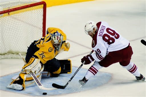 Nashville Predators goalie Pekka Rinne (35), of Finland, stops the shot of Phoenix Coyotes right wing Mikkel Boedker (89), of Denmark, in the first period of Game 4 in an NHL hockey Stanley Cup Western Conference semifinal playoff series, Friday, May 4, 2012, in Nashville, Tenn. (AP Photo/Mike Strasinger)