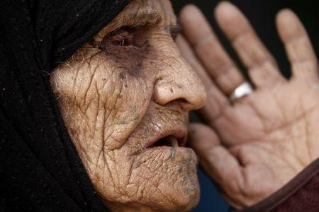 Khatla Ali Abdullah, 90, who recently fled her house in Al Mamoun district speaks with a Reuters journalist as she sits at her tent in Hammam al Alil camp, while Iraqi forces battle with Islamic State militants, in western Mosul, Iraq March 1, 2017.   REUTERS/Zohra Bensemra
