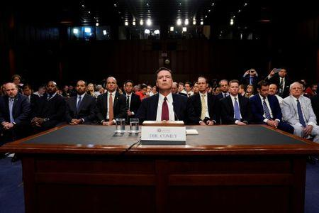 FILE PHOTO: Former FBI Director James Comey testifies before a Senate Intelligence Committee hearing on Russia's alleged interference in the 2016 U.S. presidential election on Capitol Hill in Washington, U.S., June 8, 2017. REUTERS/Jonathan Ernst