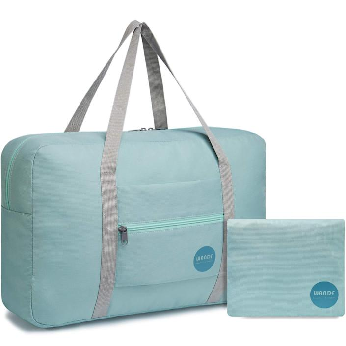 """<h2>WANDF Foldable Travel Duffle</h2><br>We've already done <a href=""""https://www.refinery29.com/en-us/amazon-travel-duffel-bag-carry-on-review"""" rel=""""nofollow noopener"""" target=""""_blank"""" data-ylk=""""slk:plenty of raving"""" class=""""link rapid-noclick-resp"""">plenty of raving</a> about this bag, but its compact size, ability to fit an extensive amount of clothing, and can't-be-beat price point make it the ultimate weekender. <br><br><em>Shop </em><strong><em><a href=""""https://amzn.to/3eP3eE0"""" rel=""""nofollow noopener"""" target=""""_blank"""" data-ylk=""""slk:WANDF"""" class=""""link rapid-noclick-resp"""">WANDF</a></em></strong><br><br><strong>WANDF</strong> Wandf Foldable Travel Duffel Bag Luggage Sports Gym Water Resistant Nylon, $, available at <a href=""""https://amzn.to/33F0RO2"""" rel=""""nofollow noopener"""" target=""""_blank"""" data-ylk=""""slk:Amazon"""" class=""""link rapid-noclick-resp"""">Amazon</a>"""
