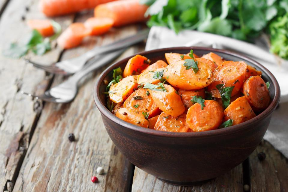 """<p>You can never have too many tasty, colorful veggie sides at a holiday dinner, and it doesn't get any easier than these carrots. A bit of sugar helps the naturally sweet veggie caramelize slightly, making this a family-friendly favorite.</p> <p><a href=""""https://www.thedailymeal.com/roasted-caramelized-carrots-recipe?referrer=yahoo&category=beauty_food&include_utm=1&utm_medium=referral&utm_source=yahoo&utm_campaign=feed"""" rel=""""nofollow noopener"""" target=""""_blank"""" data-ylk=""""slk:For the Roasted Caramelized Carrots recipe, click here."""" class=""""link rapid-noclick-resp"""">For the Roasted Caramelized Carrots recipe, click here.</a></p>"""