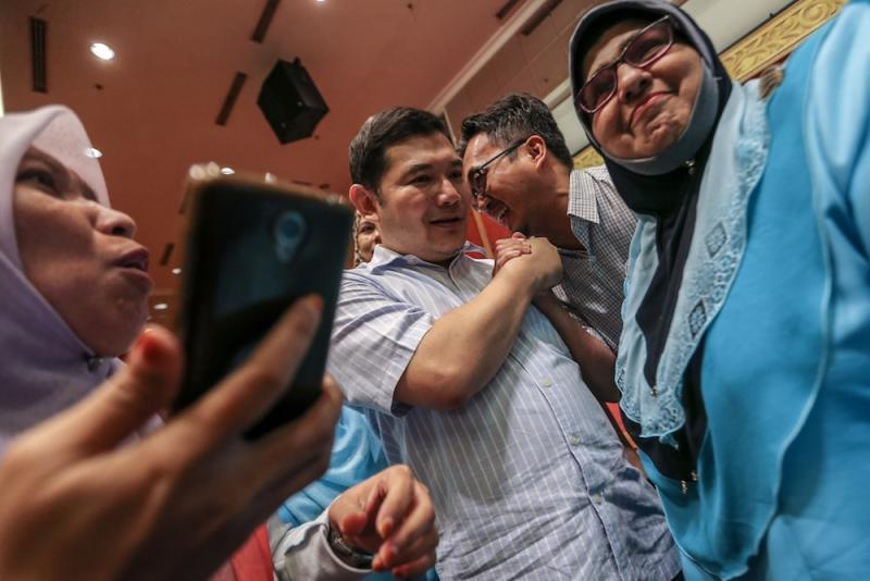 Rafizi Ramli is greeted by supporters at PKR's 20th anniversary celebration of the Reformasi movement in Shah Alam September 21, 2018. — Picture by Hari Anggara