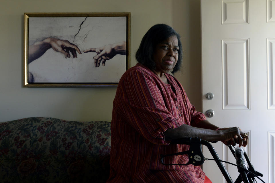 Debra Smith, 57, who has health problems that prevent her from working, rests on a walker near her front door on Thursday, Oct. 7, 2021, in Spring Hill, Tenn. Smith has about $10,000 in unpaid medical bills. Patient advocates and some state governments say hospitals must do more to help patients deal with medical bills before the debt winds up in collections. (AP Photo/Mark Zaleski)