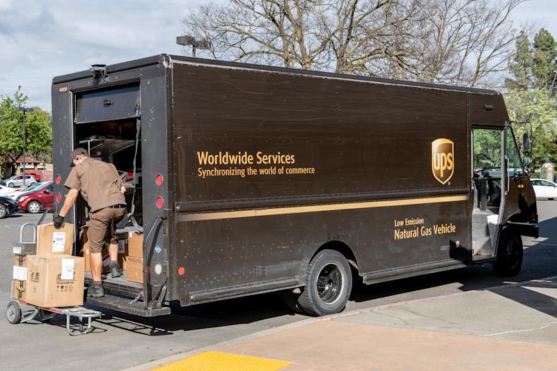 Davis, CA, USA 03/20/2019 - UPS delivery vehicle and busy worker in the city of Davis, CA. UPS is one of the largest package company headquartered in Sandy Springs, Georgia.