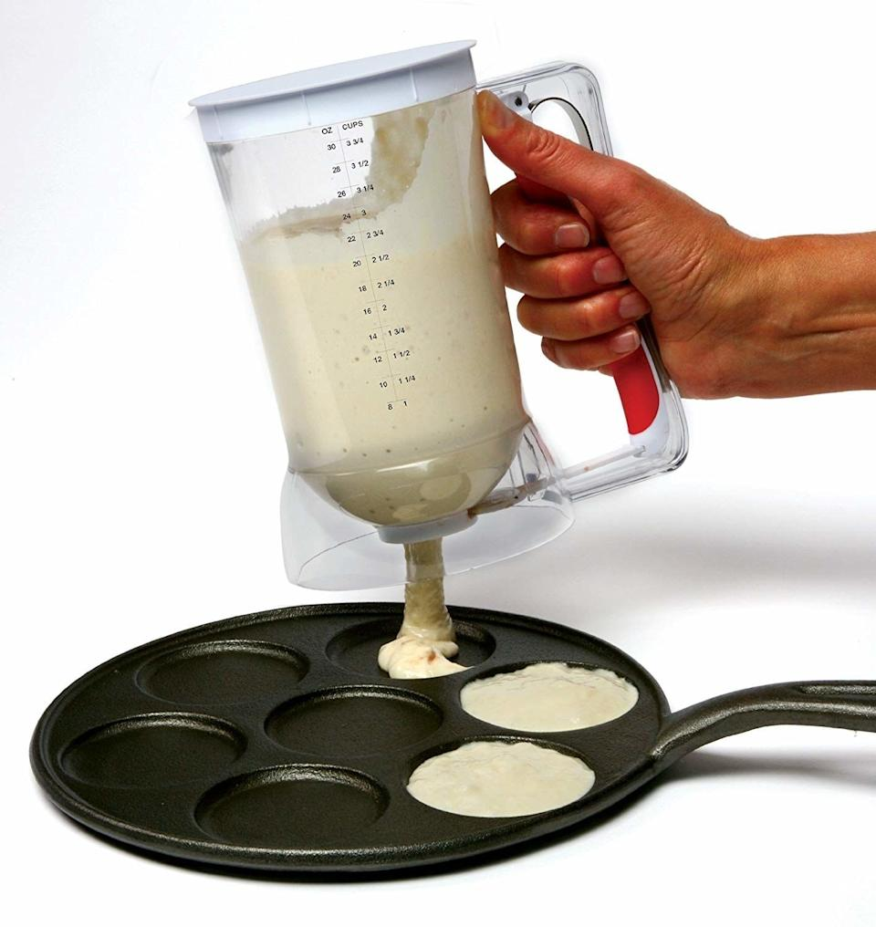 """Making pancakes will be so easy with this that they <i>miiiight</i> just replace every meal. It not only saves you extra cleanup by letting you mix the ingredients directly in it, but it also squeezes out perfectly round pancakes straight from the nozzle.<br /><br /><strong>Promising review:</strong>""""Super glad I purchased this.<strong>So much easier and faster-making pancakes</strong>. Much cleaner filling cupcakes. Easy to clean. Super easy to use. No issues with leaking. Has held up fine in the top rack of the dishwasher. Being that I'm lazy and hate dirtying extra dishes, I mix my batter directly in the dispenser."""" —<a href=""""https://www.amazon.com/gp/customer-reviews/R1T0L7927SOPLT?ASIN=B005XPES9Q&ie=UTF8&linkCode=ll2&tag=huffpost-bfsyndication-20&linkId=eca3a2073046e3db8db03b6a43acd83d&language=en_US&ref_=as_li_ss_tl"""" target=""""_blank"""" rel=""""noopener noreferrer"""">Ams</a><br /><strong><br />Get it from Amazon for<a href=""""https://www.amazon.com/Norpro-1013-Batter-Dispenser/dp/B005XPES9Q?&linkCode=ll1&tag=huffpost-bfsyndication-20&linkId=656f5f8323ba05dd05e5a880d7c4c3b4&language=en_US&ref_=as_li_ss_tl"""" target=""""_blank"""" rel=""""noopener noreferrer"""">$18.46</a>.</strong>"""