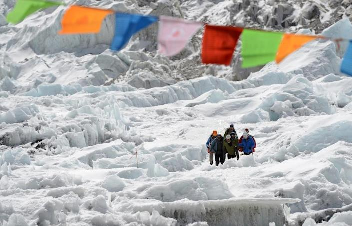 Mount Everest was first ascended in 1953, but the route to the top is still as deadly as ever: eleven people died during the 2019 climbing season (AFP Photo/PRAKASH MATHEMA)