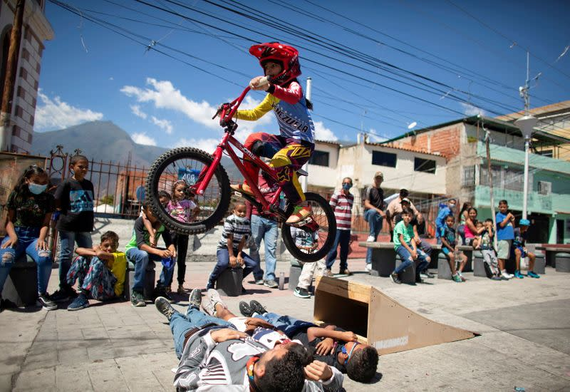 Iachini performs with her bike during celebrations for the 400th anniversary of the founding of the neighbourhood Petare in Caracas