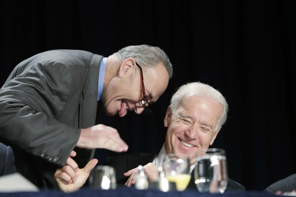 WASHINGTON - FEBRUARY 7:  U.S. Sen. Chuck Schumer (D-NY) and U.S. Vice President Joe Biden laugh during the National Prayer Breakfast at the Washington Hilton February 7, 2013 in Washington, DC. U.S. President Barack Obama reportedly used the occasion to call for unity and common ground Washington politics.   (Photo by Chris Kleponis-Pool/Getty Images)
