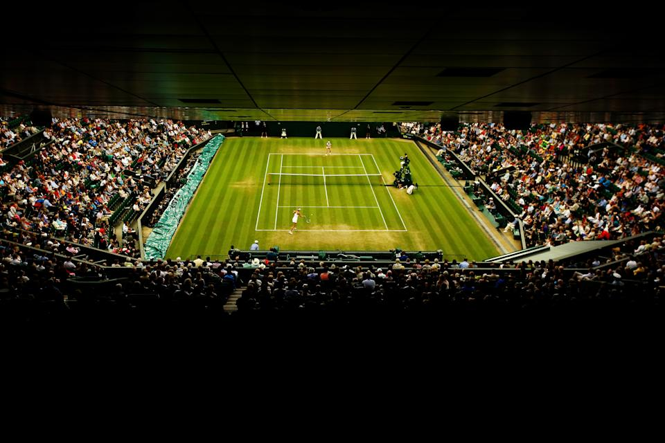 LONDON, ENGLAND - JUNE 28:  A general view of Centre court as Alison Riske of the United States plays against Maria Sharapova of Russia in their Ladies' Singles third round match on day six of the Wimbledon Lawn Tennis Championships at the All England Lawn Tennis and Croquet Club at Wimbledon on June 28, 2014 in London, England.  (Photo by Al Bello/Getty Images)