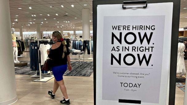 PHOTO: A customer walks behind a sign at a Nordstrom store seeking employees, May 21, 2021, in Coral Gables, Fla. (Marta Lavandier/AP)