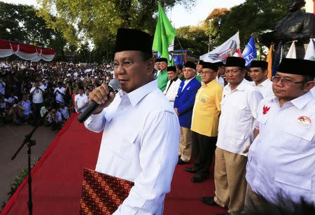 Indonesian presidential candidate Prabowo Subianto talks to his supporters during a signing ceremony of an agreement of his coalition parties in Jakarta