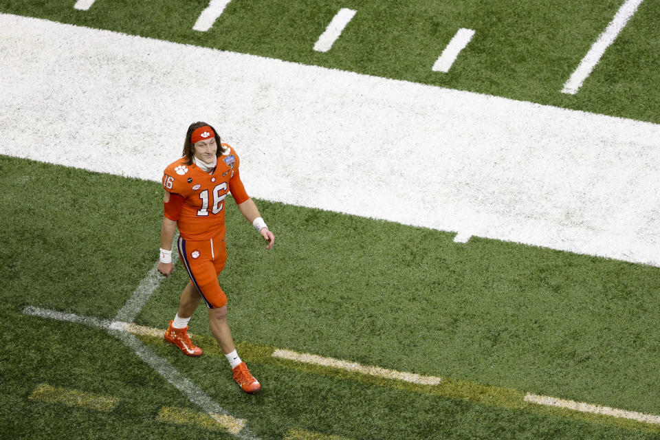 Clemson quarterback Trevor Lawrence had a tough night at the Sugar Bowl while his next potential coach in the NFL was looking on. (AP Photo/Butch Dill)