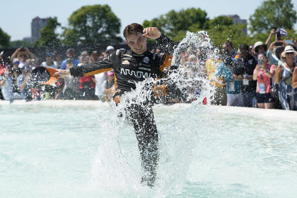 Pato O'Ward celebrates by jumping into James Scott Memorial Fountain after winning the second race of the IndyCar Detroit Grand Prix auto racing doubleheader on Belle Isle in Detroit Sunday, June 13, 2021. (AP Photo/Paul Sancya)