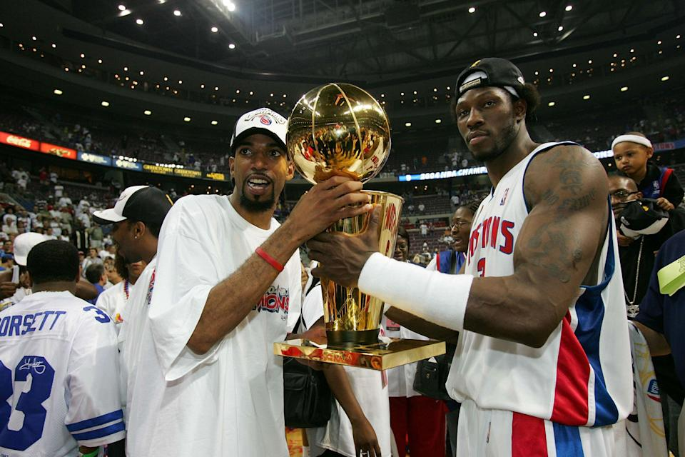 Richard Hamilton and Ben Wallace celebrate their title victory. (Getty Images)
