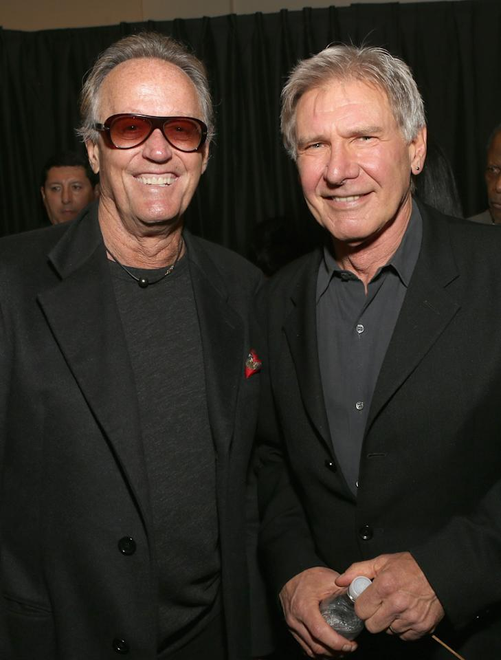HOLLYWOOD, CA - APRIL 24: (L-R) Actors Peter Fonda and Harrison Ford attend Target Presents AFI's Night at the Movies at ArcLight Cinemas on April 24, 2013 in Hollywood, California.  (Photo by Jesse Grant/Getty Images for AFI)