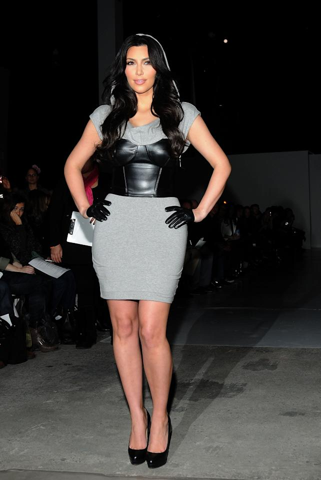 <p>Kim sat front row during New York Fashion Week, styling a leather bustier over a jersey dress, complete with finger-length gloves.</p>
