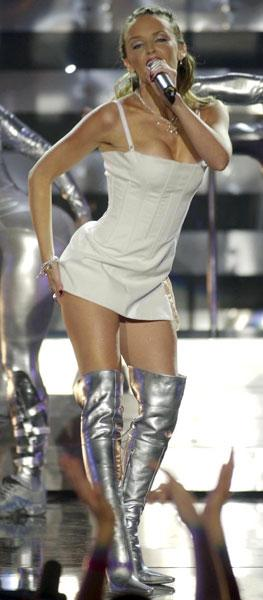 <b>Kylie performing at the Brits, 2002</b><br><br>Ms. Minogue showed off her figure in this thigh-high, white dress with a boned structure and over-the-knee silver boots, which are set to make another appearance.