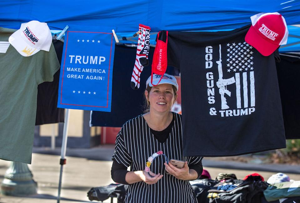 A woman sells Donald Trump hats and shirts at an election protest for Trump supporters on December 20. Source: Getty