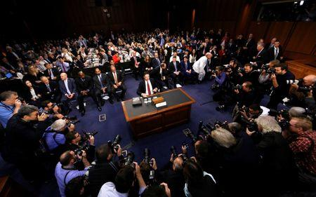 """FILE PHOTO: Former FBI Director James Comey prepares to testify before a Senate Intelligence Committee hearing on """"Russian Federation Efforts to Interfere in the 2016 U.S. Elections"""" on Capitol Hill in Washington, U.S. June 8, 2017. REUTERS/Jim Bourg/File Photo"""